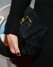 Francesca Eastwood stashed her night-out essentials in a black leather bag with gold hardware.