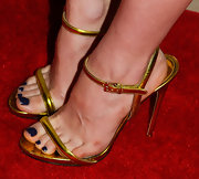 Francesca paired strappy gold sandals with a navy pedicure.