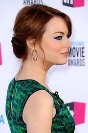 Emma Stone wore her hair in a romantic twisted updo with pretty loose tendrils at the 17th Annual Critics' Choice Movie Awards.