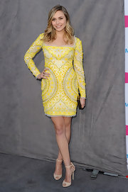 Elizabeth Olsen accessorized her intricately beaded cocktail dress with nude strappy sandals.