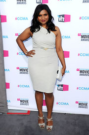 Mindy Kaling paired her one-shoulder cocktail dress with embellished platform sandals.