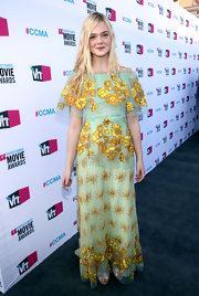 Elle Fanning looked perfectly youthful at the Critics' Choice Awards in a mint dress with yellow embroidery.