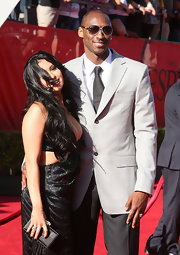 Vanessa Bryant attended the ESPY Awards carrying a YSL letter clutch.