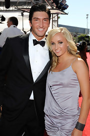 Nastia wears her hair in long beachy waves, with a simple side part.  Here she's with friend and Olympic champ Evan Lysacek.