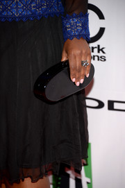 Octavia Spencer accessorized with a low-key Edie Parker hard-case clutch when she attended the Hollywood Film Awards.