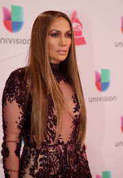 Jennifer Lopez wore her long tresses loose in a sleek straight style during the Latin Grammy Awards.