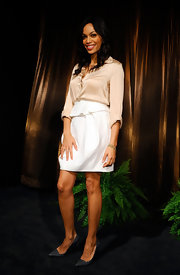 Rosario Dawson donned demure gray pointy toe pumps with her pastel ensemble.