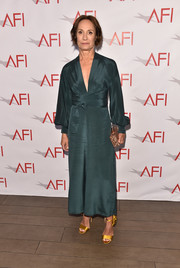 Laurie Metcalf looked effortlessly stylish in a teal wrap-style dress by Dhela at the 2018 AFI Awards.