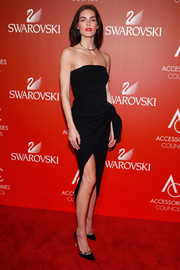 Hilary Rhoda showed off her supermodel figure in a strapless LBD with knot detailing while attending the ACE Awards.