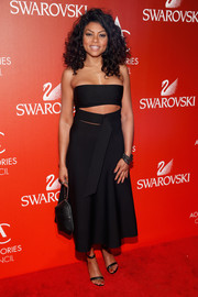 Taraji P. Henson flaunted her toned abs and arms at the ACE Awards in an Alexander Wang strapless LBD boasting a midriff cutout with strap detail.