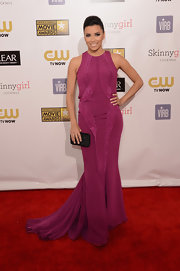Eva Longoria chose a textured black velvet clutch by Ferragamo to pair with her fuchsia gown.