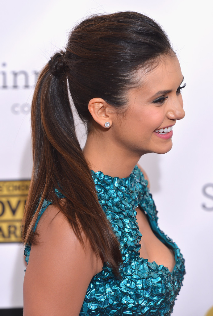 Actress Nina Dobrev arrives at the 18th Annual Critics' Choice Movie Awards at Barker Hangar on January 10, 2013 in Santa Monica, California.