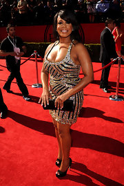Niecy opted for platform, peep toe pumps with a glitzy mini dress.