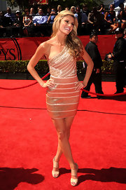 Erin dazzled in a sequined, one shoulder look with nude sandals and flowing waves.