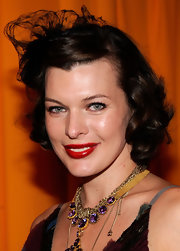 Model and Actress Mila Jovovich looked ultra-retro in her lace veil and simple curls.
