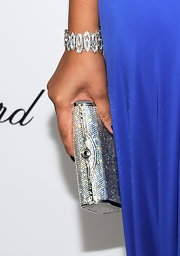 TV personality and fashion designer Kimora Lee Simmons paired her cobalt blue dress with a dazzling gemstone inlaid box clutch.