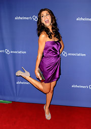 An elated Miss Harris kicked up her heels wearing a cute pair of peep-toed blush platform pumps. The neutral heels emphasized her bronzed skintone and complemented her pretty purple mini.