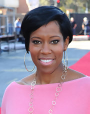 Regina King wore a sheer glossy pink lipstick while attending the 18th Annual SAG Awards rehearsals.