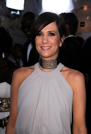 Kristen Wiig attended the 18th Annual SAG Awards wearing a 19th century diamond lattice choker in silver and gold along diamond stud earrings.