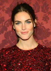 It would take more than this mussed-up ponytail to make Hilary Rhoda less than gorgeous!