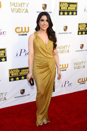 Caren Brooks channeled her inner goddess in this gold wrap gown during the Critics' Choice Awards.