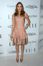 Christa's nude drop-waist dress was a fun take on a classic style.