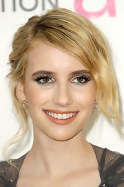 Emma Roberts topped off her flawless look with shimmering nude lipstick.