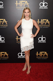 Reese Witherspoon styled her dress with gold glitter sandals by Saint Laurent.