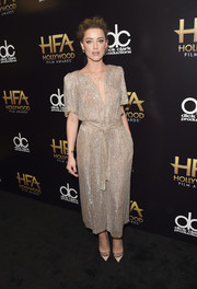 Amber Heard was all about easy elegance in a beaded gold jumpsuit by Temperley London at the Hollywood Film Awards.