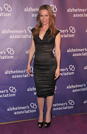 Leslie Mann donned black platform knot detail peep toes to the 19th Annual A Night at Sardi's fundraiser.