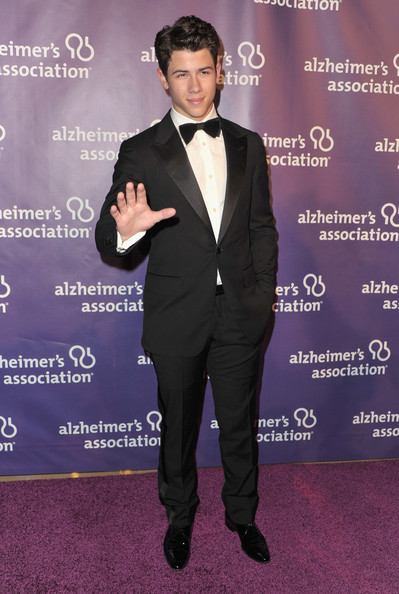 Nick Jones showed off a more grown up side in a classic tuxedo equipped with a black bow tie.
