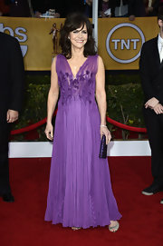 Sally Field was picturesque in this lovely purple pleated gown with a delicately appliqued bodice.