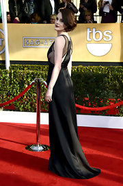 Michelle Dockery looked modest yet revealing in this black satin gown with sheer insets.