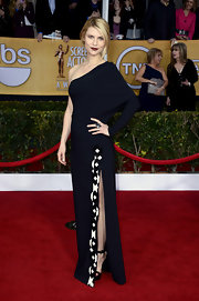 Claire Danes brought the drama in her dark lip and artistic single-sleeve gown.