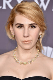 Zosia Mamet got all prettied up with this loose ponytail for the amfAR New York Gala.