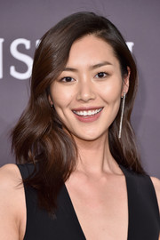 Liu Wen looked lovely with her soft waves at the amfAR New York Gala.