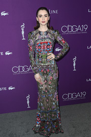 Lily Collins mesmerized in an ornately sequined, sheer gown by Alexander McQueen at the Costume Designers Guild Awards.