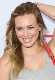 Hilary Duff achieved a natural look with subtle lip color at the Children Mending Hearts Style Sunday.