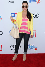 Kyle Richards sported a nice blend of colors at the Children Mending Hearts Style Sunday with this yellow cropped jacket and striped shirt combo.