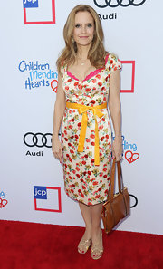 Kelly Preston was a pretty mix of colors at the Children Mending Hearts Style Sunday in a floral frock adorned with a bowed yellow belt.