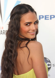 Jordana flaunts with the camera, wearing her hair in a partial braid with wavy curls.