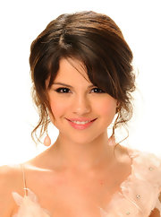 Selena's wispy ringlets make her updo a particularly romantic hairstyle.