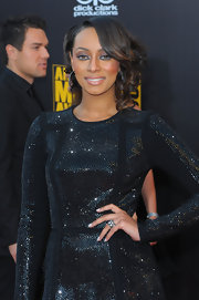 Keri Hilson changed up her hair again for the American Music Awards where she sported asymmetrical curls.