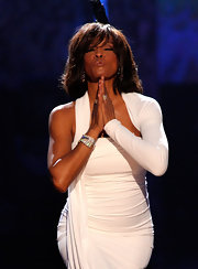 Whitney Houston performed on stage in this white one-shoulder dress.
