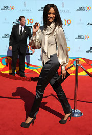 "Tyra's BET look didn't recieve rave reviews but at least she got the shoes right! Her grey suede platfom ""Tribute Too"" pumps are an amazing shoe that are always sexy and perfect for the red carpet."