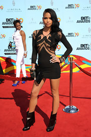 Cassie continued to show off her edgy new style when she hit the red carpet at the BET awards wearing a shocking peek-a-boo black mini dress and zippered, fold over boots. The black leather heels can go from the red carpet to the streets with skinny jeans or leggings.
