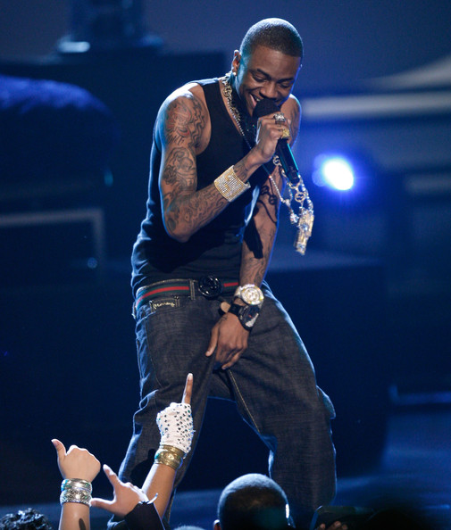 Soulja Boy rocked out on stage while showing off his unique arm tattoos.