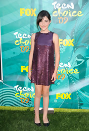 Isabelle wears a violet sequined shift dress.  Perfectly age appropriate for the Teen Choice Awards.