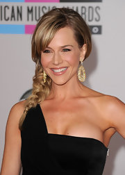 Julie Benz showed off her long braided hairstyle while attending the American Music Awards. The actress completed her look with blunt cut bangs and gold earrings.