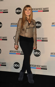 Jennette McCurdy paired her suede Moxy boots with a metallic gold leather jacket.